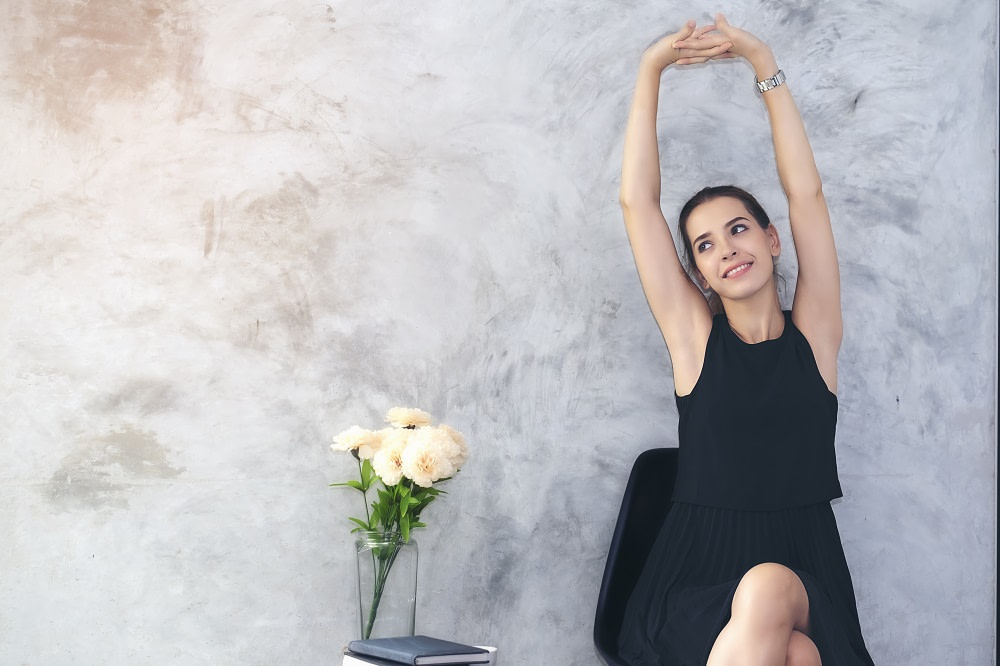 Woman in black dress stretching
