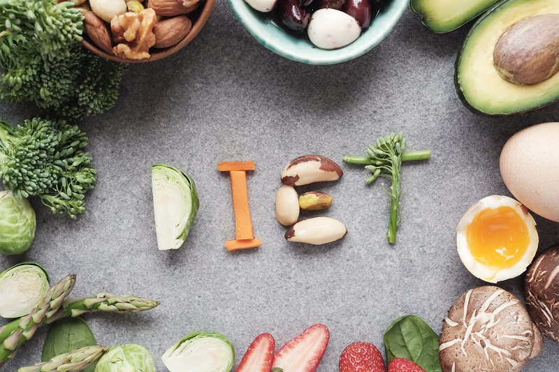 The word diet written with healthy foods