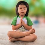 Small girl meditating