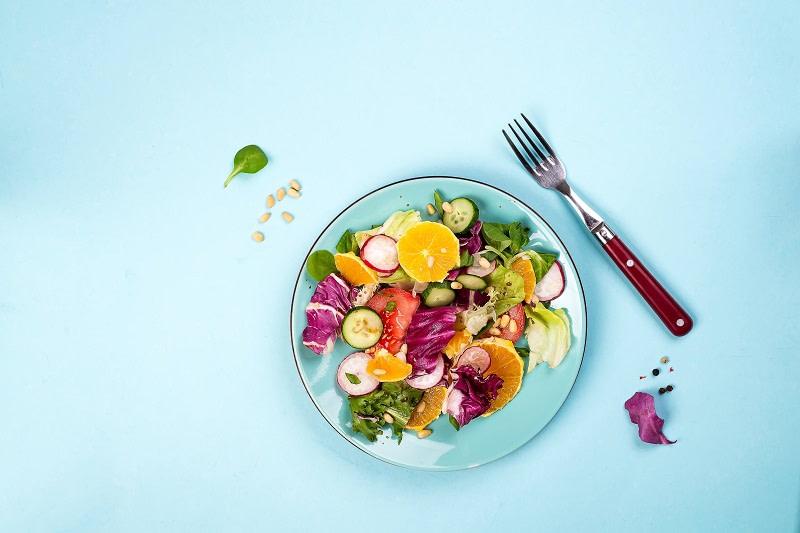 Healthy fruit ad vegetables on blue background